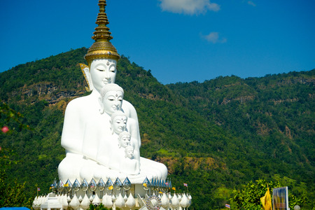 Big White Buddha Statue with mountain and blue sky background at Wat Phasornkaew in Thailand. Photo taken on: 29 November , 2016 Stock Photo