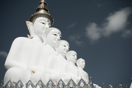 Big White Buddha Statue with  blue sky background at Wat Phasornkaew in Thailand. Photo taken on: 29 November , 2016