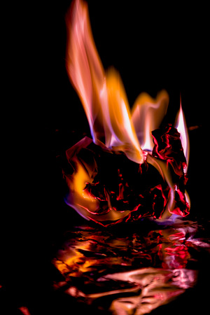 ardent: Beautiful concept flames. Fire on burns paper with black background. Soft Focus