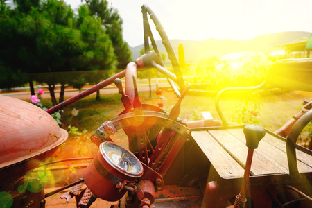 Closeup view of the old machine of tractor. Soft focus and lighting flare effect