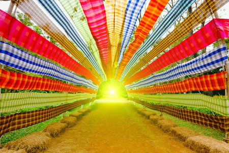 Colorful bar of Loincloth with lighting flare effect at countryside, Thailand. Stock Photo
