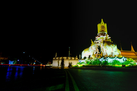 Night view image of  statues of Thai White Elephants and symbols Thailand King Rama 9,in front of the Grand Palace or Emerald Buddha Temple. Stock Photo