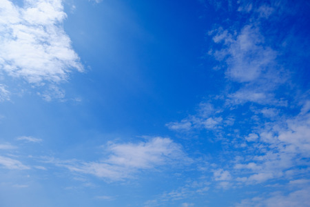 nebulosity: white fluffy clouds in the blue sky. Stock Photo