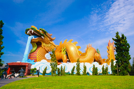 Big dragon at Dragon descendants public museum with blue sky background at  Suphanburi city, Thailand