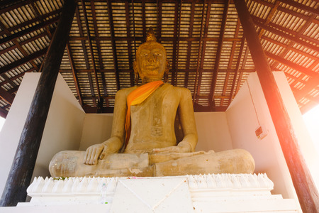 Buddhist statue in old chapel at Wat Sri Rattana Mahathat. this old temple built 600 years ago in Suphanburi, Thailand
