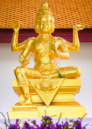 Statue of Hindu God Brahma in Thailand. Beautiful Indian religion traditional lord sculpture with for faces in a Public shrine Stock Photo
