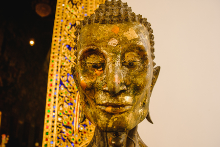 close up face on starving Buddha  head statue with lighting effect.  Selective focus face buddha statue.