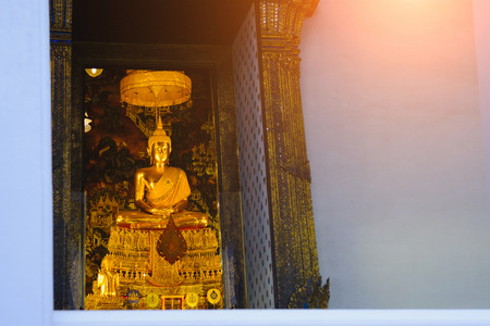 Buddha gold statue with thai art architecture in church Wat Pho (Temple of the Reclining Buddha). This is a Buddhist temple in Bangkok,Thailand.