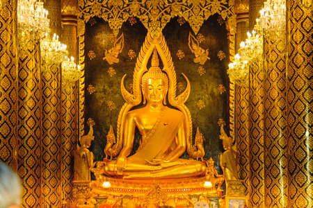 Gold sculpture of the Buddha statue, known as Phra Phuttha Chinnarat at Wat Phra Sri Rattana Mahathat temple and most beautiful buddha in Thailand.