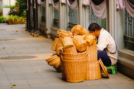 basket weaving: Bangkok, Thailand - February 10, 2017: Unidentified seller weaving items from the vine. Basket Weaving in Bangkok, thailand