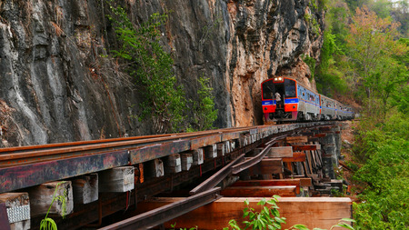 infra construction: Trains running on railways track crossing kwai river in kanchanaburi thailand this railways important destination of world war II history builted by soldier prisoners Stock Photo