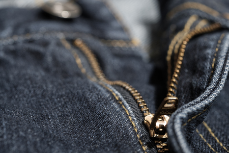 Jean with gold zipper. selected focus. background and textures.