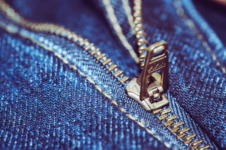 Blue Jean with gold zipper. selected focus. background and textures.