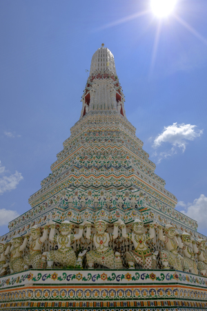 Detail old thai art architecture of main Pagoda at Wat Arun buddhist temple which is a public place, Bangkok Thailand.