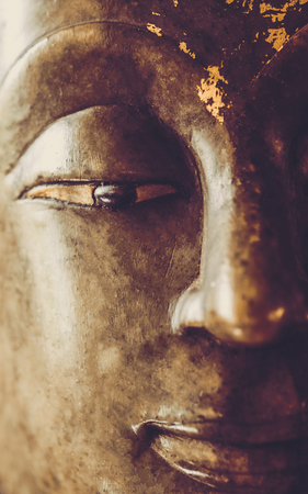 close up image on face on buddha head statue.Selective focus face buddha statue. Stock Photo