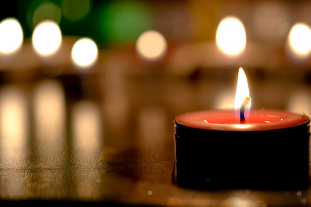 concep: Retro candle light with soft light background in the Church - Prayer and hope concep.