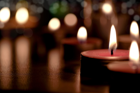 Prayer and hope concept - Retro candle light in the Church. Vintage image. Standard-Bild