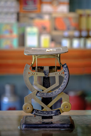The old scales balance weight machine in vintage herb store. Bangkok,Thailand.