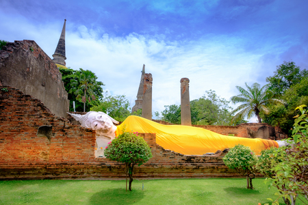 Reclining Buddha is a statue that represents Buddha lying down and is a major iconographic and statuary pattern of Buddhism at Wat Yai Chai Mongkol, Ayutthaya historical park, Thailand. Reklamní fotografie