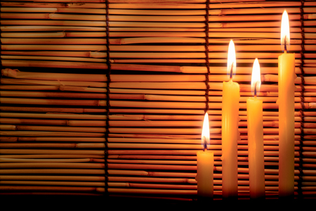 memorial cross: Group of candle light on blurred old wooden background at the night. Selective focus on tha candle with soft  light effect. Foto de archivo