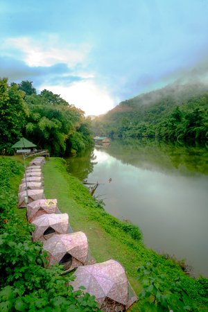 Tent camping on Mountain forest with fog and rain on Kwai river in Erawan National Park, Kanchanaburi, Thailand. Stock Photo