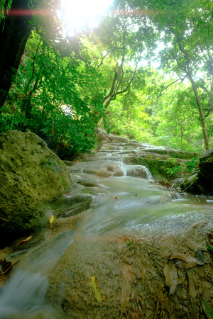 Amazing beautiful deep forest waterfall in Erawan National Park, Kanchanaburi, Thailand. Stock Photo