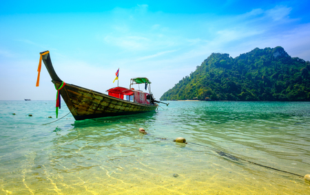 Concept of travel and relax. Beautiful local fishing boats on sea blue Railay beach, Krabi Thailand .