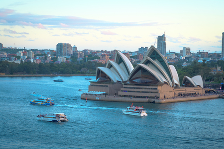 November 28, 2017 - Sydney, Australia: The Sydney Opera House with ferries boats in the foreground, taken from the Harbor Bridge in Sydney, Australia Editorial