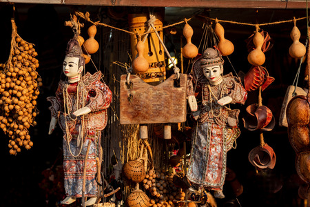Traditional Myanmar puppet doll (Burmese marionettes) Street market at mon bridge represent thailand tourism