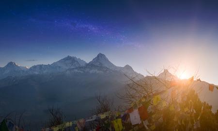 Rows of Tibetan prayer flags at Annapurna Base Camp road. Trekking in Himalaya mountains, Nepal. Nature landscape.