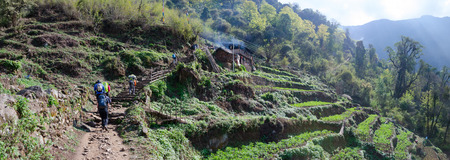 Panoramic mountain landscape. Mountain landscape in the Himalayas. The house on the way to the foothill of Annapurna range, Nepal Himalayas. travel concept and camping.
