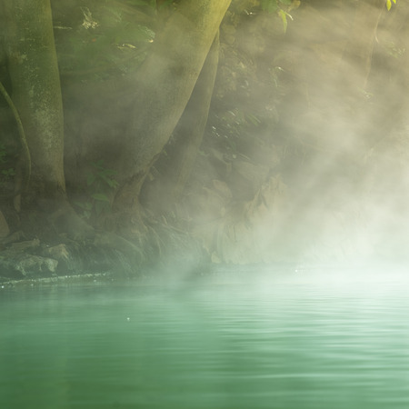 Morning is beautiful fog steam hot spring with sunlight at Hin Dat Hot Spring , Kanchanaburi , Thailand.