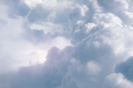 Autumn sky background of soft clouds with dark colors and very gray clouds in blue sky. 写真素材