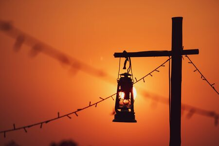 vintage oil lamp  with the Sun is going to fall. Evening. light after Sunset.