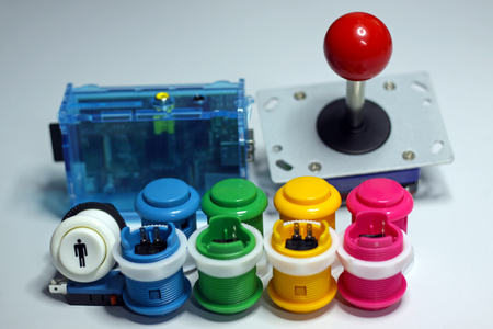 arcades: Arcade buttons and red ball joystick for arcade video games Stock Photo