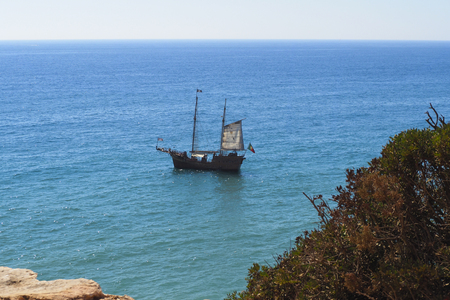 A view of a boat on Praia da Rocha in Portimao, Algarve region, Portugal