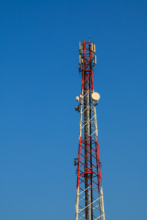 signaling: Telecommunication tower for cellular signaling and communication with blue sky. Stock Photo