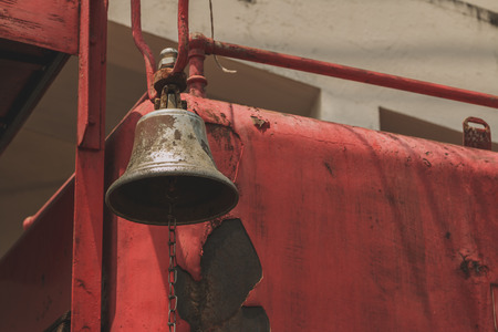 antique fire truck: Bell of the old fire engine. Process with Vintage tone. Stock Photo