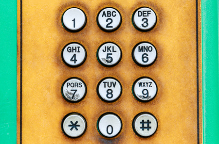 dial pad: Numeric keypad of public telephone.