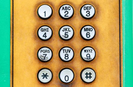 teclado numerico: Teclado numérico del teléfono público.
