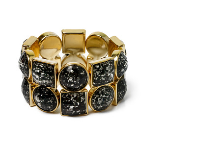 bangles hand: black and gold bracelet on white background.
