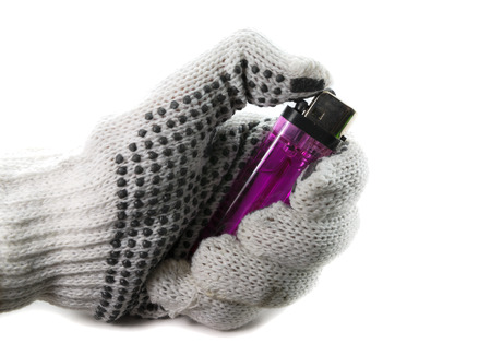 gloved: gloved hand holding a lighter on a white background, safety first concept