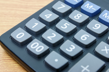 4 3 display: calculator number one button on a wooden. Stock Photo