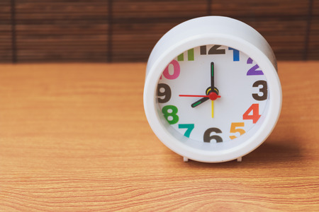 o'clock: clock on wooden showing 8 oclock Stock Photo