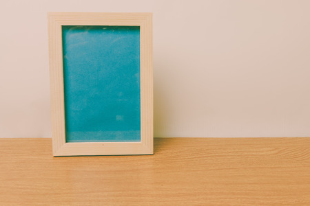 blank photo: picture frame on a wooden, vintage tone process.