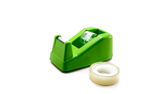 sellotape: green scotch tape holder on a white background Stock Photo