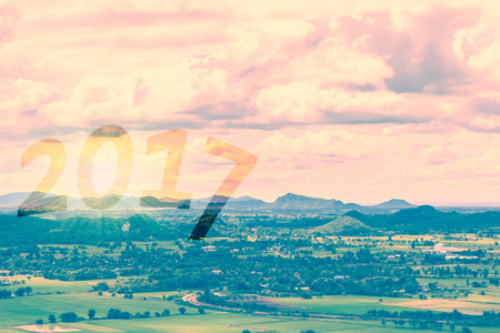 Landscape with mountain and sky. Golden glow of happy new year 2017. Retro vintage filter effect.