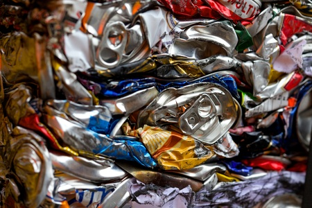 Flattened cans in a recycling centre in the UK