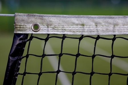 Tennis court net with band stretch accross an astro turf tennis court Stok Fotoğraf
