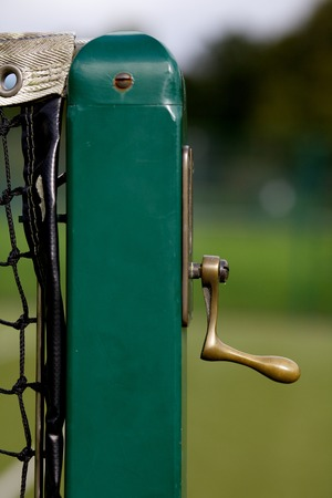 Tennis  court net handle on green post. Stok Fotoğraf